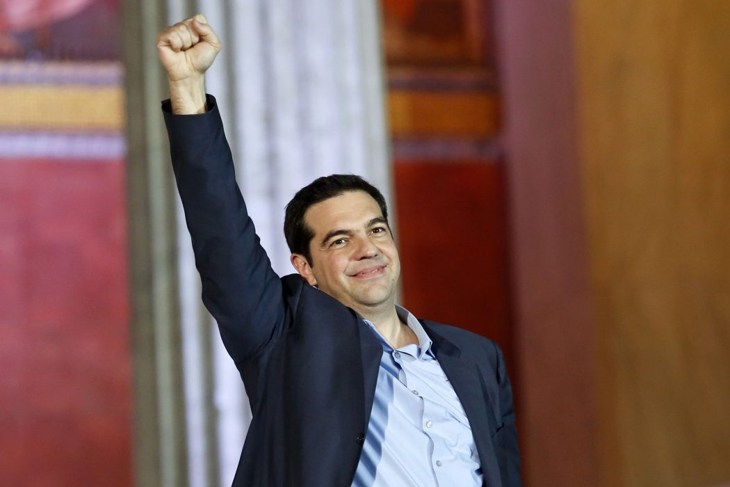 The head of radical leftist Syriza party Alexis Tsipras raises his fist to supporters after winning the elections in Athens January 25, 2015. Greek leftist leader Tsipras hailed the projected victory of his anti-austerity Syriza party in Sunday's snap election as a defeat for austerity and the EU/IMF bailout programme keeping the country afloat. REUTERS/Giorgos Moutafis (GREECE - Tags: POLITICS ELECTIONS BUSINESS TPX IMAGES OF THE DAY)