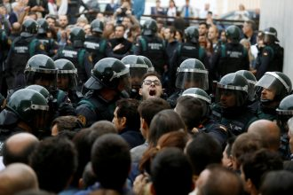 Scuffles break out as Spanish Civil Guard officers force their way through a crowd and into a polling station for the banned independence referendum where Catalan President Carles Puigdemont was supposed to vote in Sant Julia de Ramis, Spain October 1, 2017. REUTERS/Juan Medina